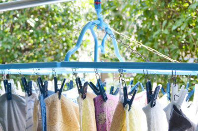 高い物干し竿に洗濯干し:家事代行